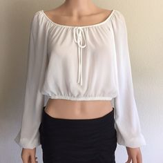 White Long Sleeve Crop Top White Long Sleeve Crop Top. Size: L by Emily+M Worne one time, Like New Emily+M Tops Crop Tops