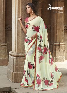Peach flowery prints looks beautiful on the offwhite georgette saree.
