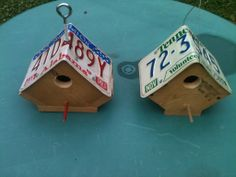 Couple of bird houses made from old car tags.