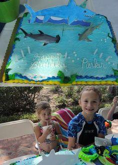 """""""Sharky the Birthday Shark"""" laminated cake topper from Invitation Monkey."""
