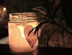 Glass jars decorated using dollies and paper heart cutouts.