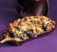 Aubergines filled with Spinach and Mushrooms ~ ~ A hearty, slow-roasted dish that looks as stunning as it tastes. Forget stuffed peppers and serve your veggie guests this sophisticated stuffed aubergine dish instead, from BBC Good Food.