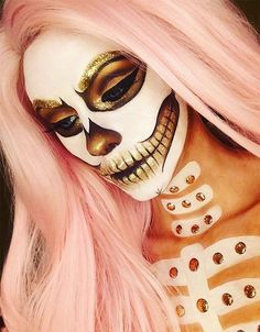 Gold Glitter Skull Makeup. Fabulous Halloween style gold and white skull makeup paired with a pastel pink wig. Discover more Halloween makeup inspiration for pink hair and pink wigs at Star Style Wigs. Click the image to see the full article.