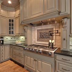 I love how the stove top and cabinets look like an antique Range