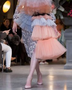 In @viktor_and_rolf's perfect world, imperfections are the ultimate beauty. Piecing together deconstructed evening wear into surreal collages, the #SS17 collection transpired into a multicolored degrade palette on asymmetrical shapes and voluminous silhouettes. Bespoke Christian Louboutin shoes walked the collection from the cerebral realm of its creators to #pfw #hautecouture. 📷 @the_kinsky