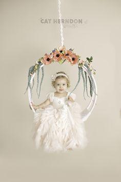 Corpus Christi photographer, Cat Herndon, focuses on fine-art portraits of newborn through the first year milestones in her downtown studio. #studio #portraits #photography #newborn #toddler #swing #pretty #ideas #posing