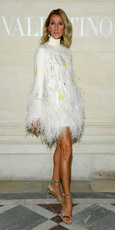 Look of the Day Celine Dion wowed in a feathered dress, metallic heels, and yellow diamond earrings while at the Valentino Haute Couture show. Celine Dion, Valentino Gowns, Feather Dress, Ruched Dress, Red Carpet Looks, Couture Dresses, Dress To Impress, Catwalk, Marie