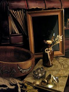 Scrying is the means of divining through gazing.  The diviner will stare into (or perhaps beyond) a dark, reflective surface.  Scrying can be done in a dark mirror, a bowl, a crystal, or a surface of water under the moonlight.