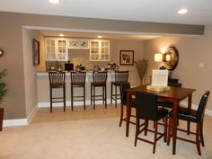 Dining Room : Home Bar Design Ideas With Ceiling Lamps Beige Walls Tile Flooring Cream Rug Wooden Table Chairs With Black Upholstery White Top Counter Wooden Stools And Glass Door Cabinets Home Bar Design Ideas Home Bar. Home Bar And Grill. Home Bar Arlington Heights.