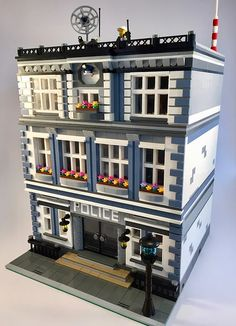 The husband and wife team of SwissTony and Pacman563 joined LEGO forces and designed a modular police station. After careful planning and building in LDD