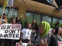 "Black Lives Matter protestors at UC Irvine were seen holding signs that read ""Blue Lives Don't Matter,"" and ""F**k the Police."""