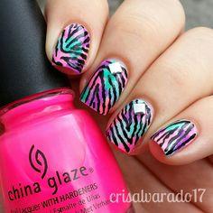 Zebra print over a faux watercolor nail art by Cristina Alvarado