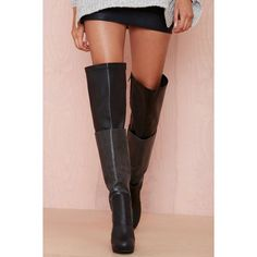 Sometimes you've just gotta take it higher. These black thigh high boots by Jeffrey Campell have a textured leather panel at center, zip closure at side, and g…