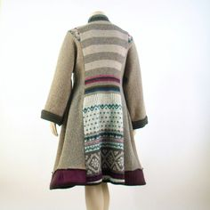 ON SALE 100% recycled one of a kind sweater coat . A Uniquely stylish handmade artsy coat, ideal to wear through fall/mild winter seasons. Unlined, made from various upcycled wool sweaters in taupe, burgundy and tan of varying Nordic patterns. One of a kind *Stand up collar *Long kimono sleeves *Deep side slit pockets *Quirky vintage button/front loop closure *Slightly fit and flared design *100%wool Dry Clean Only Fits size Large/XL US 14/16 Bust- 44-46 inches (112-117 cm) Waist- 40...