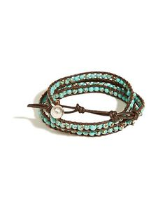 Bohemian wrap bracelet crafted from vintage-style leather, featuring intricate placed semi-precious turquoise detailing. <br/><br/>• Button closure