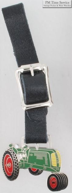 Silver-plated fancy Oliver 70 tractor large fob; watch strap & keychain options.  Starting at $13.00, on eBay!