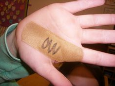 "Pinner says, ""Love this! I'm totally covering myself with bandaids when I teach this lesson! ""Ou"" and ""ow"" sounds."""