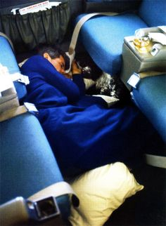 Robert F. Kennedy and his dog Freckles nap on board a plane during a campaign, 1967.