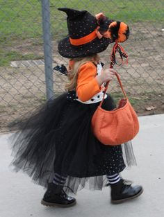 Cute Halloween costume. Pumpkin witch dress