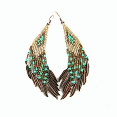 Beadwoven earrings with fringes in crystal gold, turquoise and brown colors. Made of Toho seed beads, bugle beads and copper feathers.  Length - 11 сm / 4,3 inches (including ear wires) Width - 1,9 сm /0,8 in the middle to 2,5cm/1 at the bottom Earrings are not heavy. They are very comfortable while wearing.  Gift box included.  NOTICE: Last photo is only an outlook, showing the lenght and the width of Last Leaves earrings model, not this exact color combination.  I'm an approv...