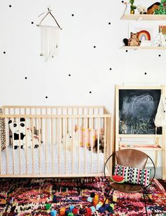 a whimsical nursery with polka dot wall decals