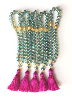 This set of 5 glass crystal tasbihs are perfect for giving as gifts to your guests or bridal party. These Islamic prayer beads are made with 33 beads each separated in groups of 11. The fuschia tassel adds a finishing touch that makes these lovely tasbeehs extra special. To order larger quantities please do not hesitate to get in touch. We would be honored to create something beautiful for your special day.