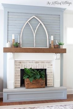 love this fireplace makeover - the planked surround, the chunky mantel, the whitewashed bricks - so cute!!!