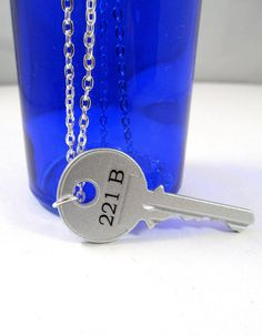 The key to 221B Baker Street!  Super cute BBC Sherlock necklace. Once again..... WHY DONT I HAVE THIS
