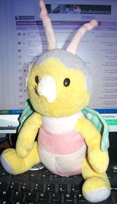 Searching – 2006 RUSS YELLOW BUG with PINK & WHITE STRIPE TUMMY & GREEN Print WINGS