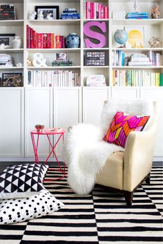 Beautiful blocked bookcase. Chic reading space that is stylishly organized by color. Believe it or not, grouping by color can not only be ey...