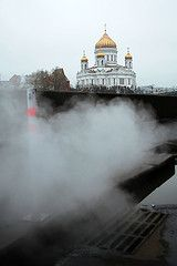 Steaming sewer with the Cathedral of Christ the Saviour in the background. Moscow, Russia