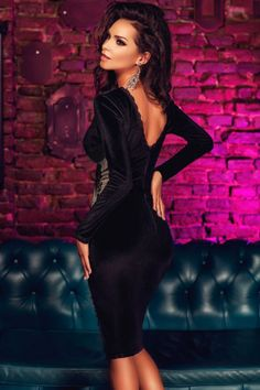An elegant and sophisticated midi dress for all your social events, this long sleeve velvet number from HisandHerFashion with fitted bodice and contrast side insert will keep you chic and festive all