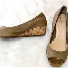 Cole Haan Nike Air Tan Cork Sole Wedges Work it! Comfortable Nike Air technology paired with perky peep toes and on trend cork heels. No one has to know how comfortable your are! Smudge to heel of right shoe as shown, over all show some gentle wear. Cole Haan Shoes Wedges