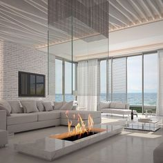 What a gorgeous #fireplace! #livingroom #familyroom #modern #modernfireplace #view #ocean #interiors #interiordesign #realestate #home #homeloans #mortgage #stearnshomeloans NMLS#1854