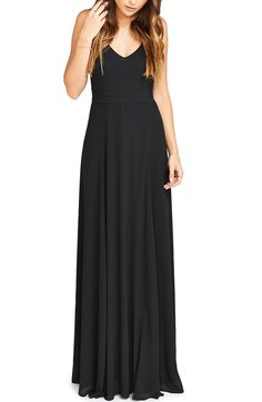 Classically feminine and undeniably flattering, this flowing chiffon gown is nipped at the waist with a tie belt and cut with an alluring front and back cutout.