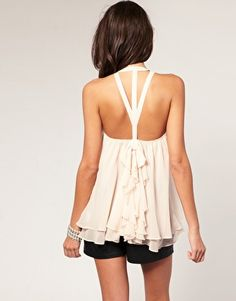 LOVE the back of this shirt. Most times I buy shirts because of the back. Open backed shirts are sexy