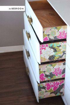 Little details. Wallpaper on drawer sides. Via The House That Lars Built.