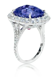 A Slideshow of a Dozen Engagement Rings for Brides Who Love Blue Gems.