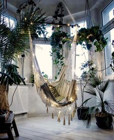 Image result for armchair surrounded by plants