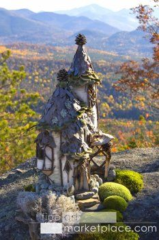 Adirondack Faerie House by Sally J. Smith   --  A fabulous Tudor-style faerie house ov bark & twig w/ pinecone-topped towers perched atop Crow Mountain in the Adirondacks