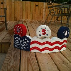 Hand Painted Curved Paver Craft -- American Flag with USA Toppers by Crafty Treasures on FB ****** Painted Bricks Crafts, Brick Crafts, Painted Pavers, Stone Crafts, Painted Rocks, Hand Painted, Painting Cement, Tole Painting, Landscaping Blocks