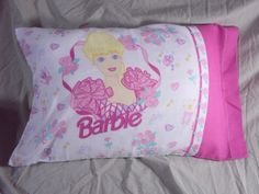 Barbie pillowcase!!!!! I had the whole bedding set! Plus we decorated my room to be like that!!