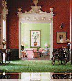 Green walls, pink/red furniture