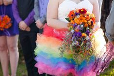 This hodgepodge of rainbows and sunny moments has lots of creative awesomeness and colorful memories! The bright rainbow dress! The boyfriend's orange vest! The quiddich robes! The skit befor… Rainbow Bouquet, Rainbow Tutu, Beach Gowns, Kids Tutu, Freaks And Geeks, Geek Wedding, Rainbow Wedding, Offbeat Bride, Wedding Flowers