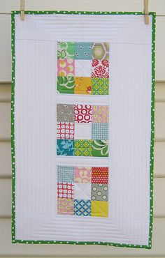Lovely mini quilt.  Great project for straight like quilting practice.