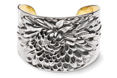 The Sunflower Cuff features clean, strong edging to complement the ...