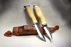 This is a double knife for hunter! In the same sheath are whittling knife and the opening knife for hunting.   http://puukkopaja.fi/index.php?lang=en