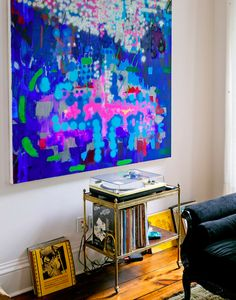 The piece above the record player is by Brooklyn artist Keltie Ferris.