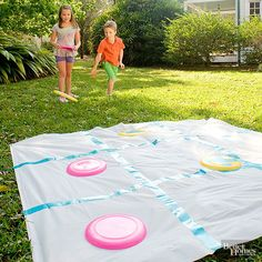 Supersize tic-tac-toe is perfect for an outdoor birthday party. Flying disks and a shower curtain transform into an easy party game. Use duct tape to block out squares on a shower curtain liner. Use more tape to mark which disks are Xs, or use color to divide the teams. Players stand behind a throw line and follow the rules of tic-tac-toe. If the disk lands off the board or in an occupied square, the player can throw again.