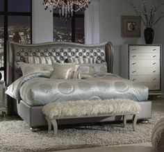 The sumptuous winged headboard on our Hollywood Swank Graphite bed is bordered with a dual nailhead  and carved rope detail and will gently send you into dreamland. Enrobed in a tufted fabric that feels silky and cool, the nested jewels sparkle in the light. | Houston TX | Gallery Furniture |